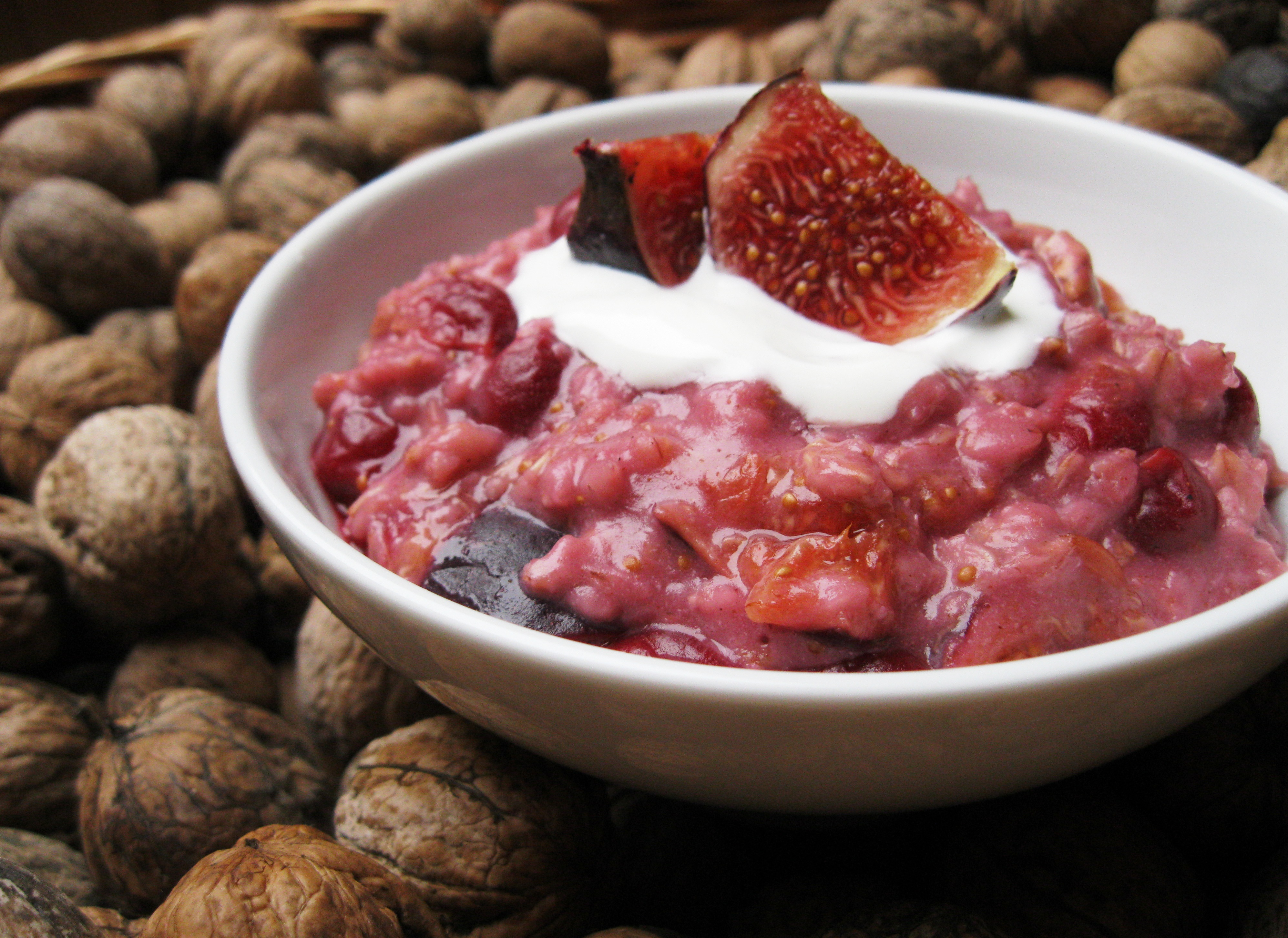 breakfast porridge with figs and cherry and walnuts